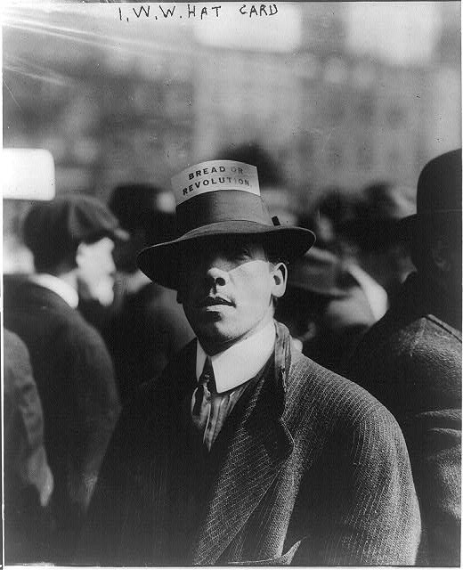 "African American protester in 1909 wearing a hat card with the words ""Bread of Revolution"""