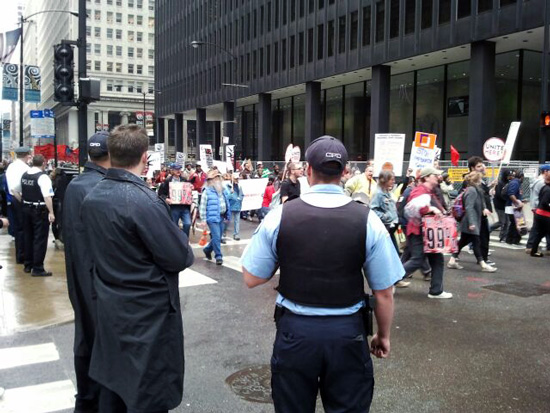 Chicago police watching the 2012 May Day parade (Credit: Susan Barsy)