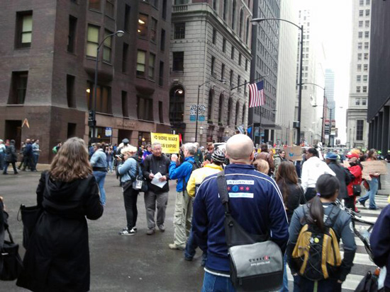Bystanders watching the Chicago May Day parade at Dearborn & Jackson (Credit: Susan Barsy)