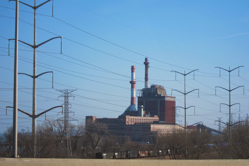 The power plant with its distinctive brick and smokestacks, from the Skyway.