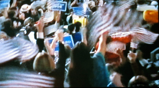 Blur of flags at the Democratic National Convention (screen shot from PBS coverage)