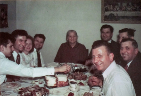 1948 photograph of Susan Barsy's ancestors at a feast table  (Credit: Our Polity)