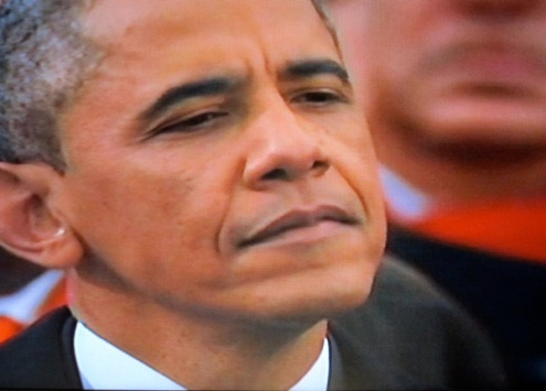 The president listening to the inaugural proceedings (Photograph of PBS coverage)