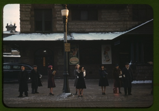 Commuters, who have just come off the train, waiting for the bus to go home, Lowell, Mass., January 1941. Photograph by Jack Delano.