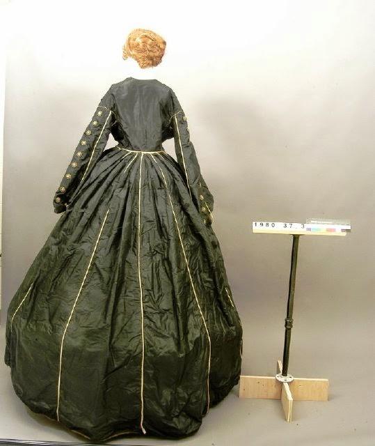 Antebellum dress with black buttons.