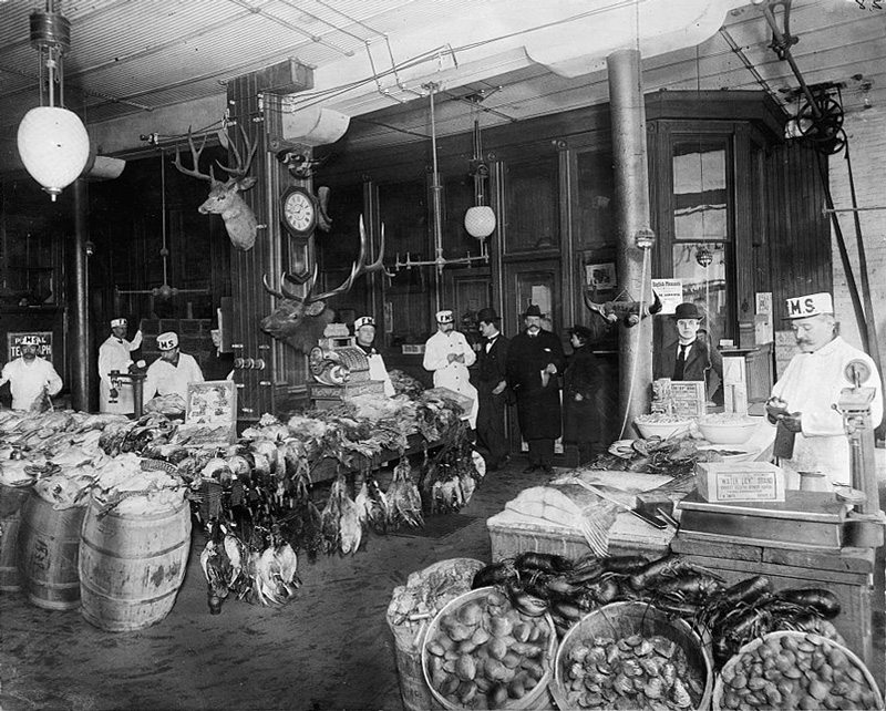 The staff and the store's wares, which included various drawn birds, heaps of lobsters, and potatoes.