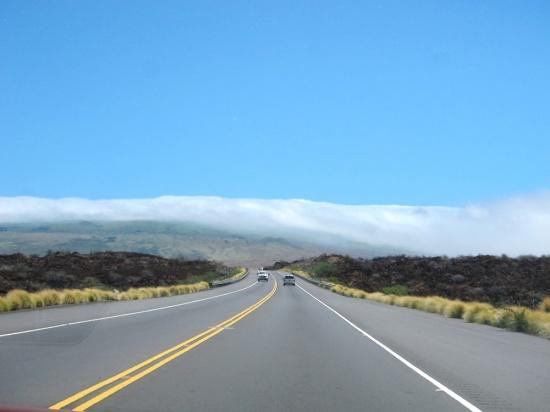 Initially the road lies through arid volcanic terrain.
