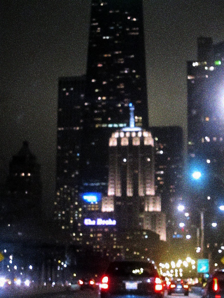 pointellized night view of the Drake and Palmolive Building from Chicago's Lake Shore Drive.