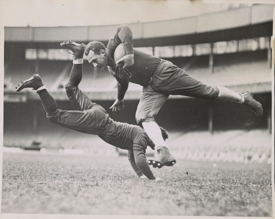 Red Grange (holding the ball) and Jim Zeller of the Chicago Bears (Courtesy of the Library of Congress)
