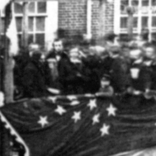 detail from the photograph above, showing Lincoln's height relative to the others present.