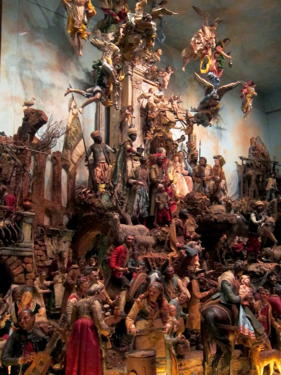 Detail showing the variety of mortal and heavenly beings the creche displays.